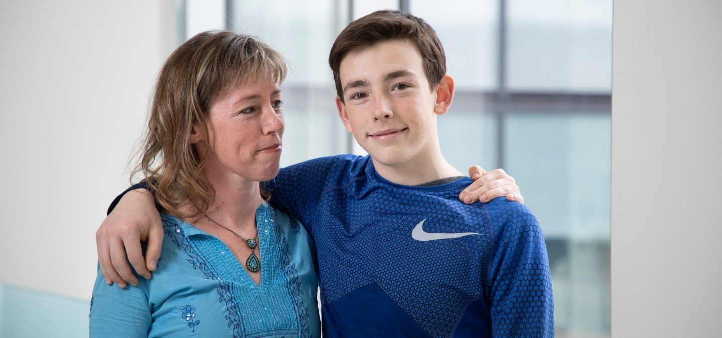 Spencer Ottens stands with his mother, Ellen Ottens