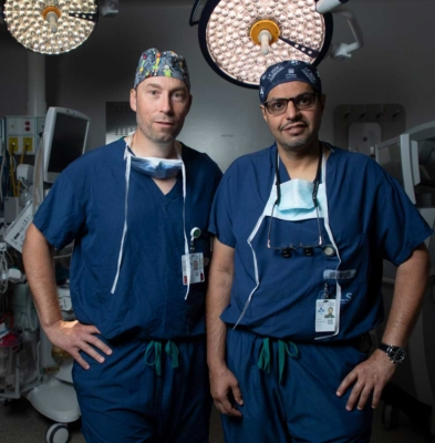 Hospital around the world are lookDr. Fahad AlKherayf and Dr. Shaun Kilty standing in an operating room at The Ottawa Hospital.