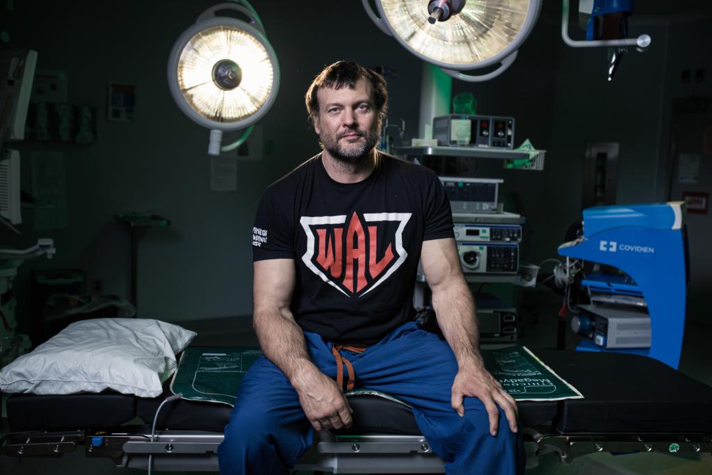 Devon Larratt sitting on an OR table