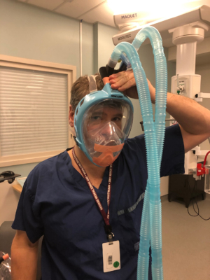 Dr. David Neilipovitz trying on a prototype mask