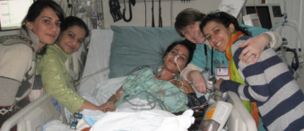 Bushra in hospital with her family.