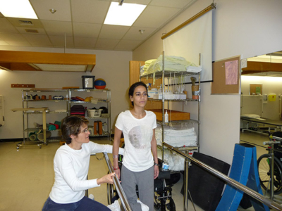 Bushra at the Rehab Centre, learning to stand.