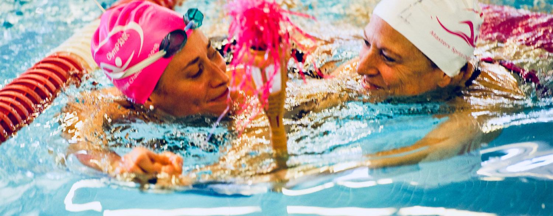 Breast cancer survivor Andrea Douglas swimming with coach Swim coach Andrea Smith.